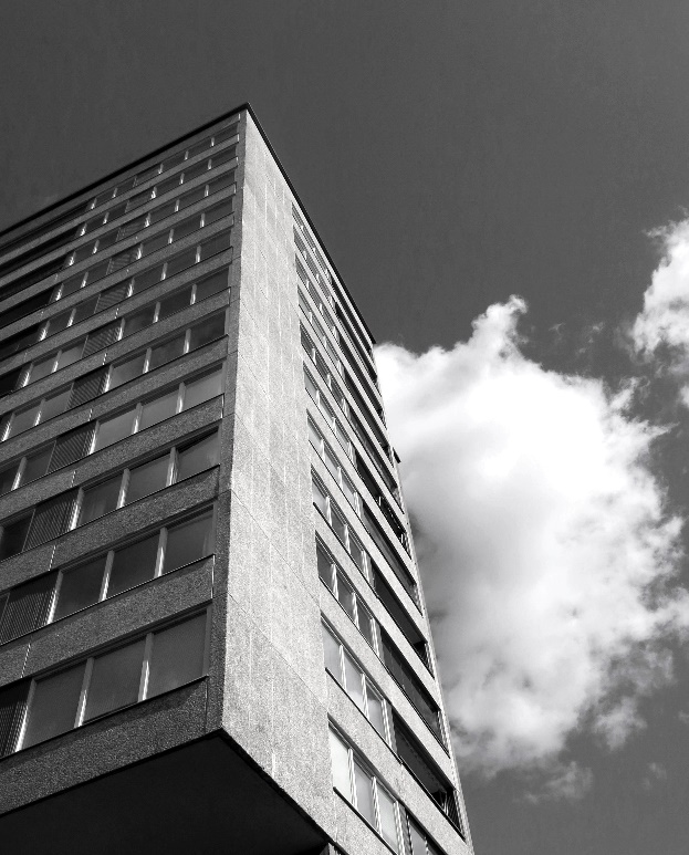 A black and white photo of a tall building Description automatically generated