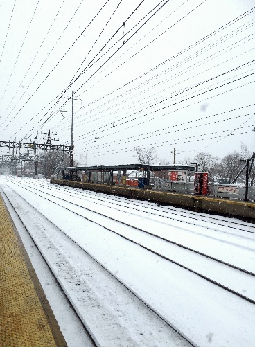 A train covered in snow Description automatically generated